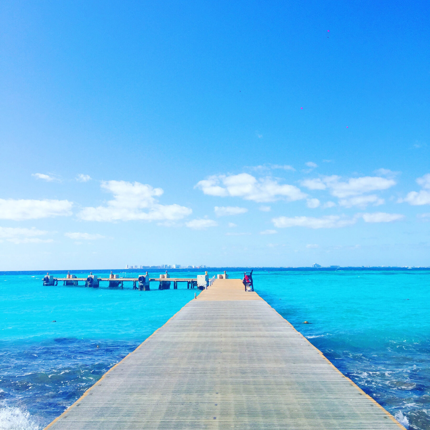 Mar azul do parque Garrafon em Isla Mujeres, Cancún